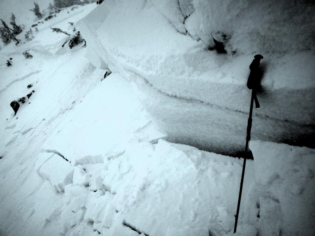 """Closeup of the <a href=""""/avalanche-terms/crown-face"""" title=""""The top fracture surface of a slab avalanche. Usually smooth, clean cut, and angled 90 degrees to the bed surface."""" class=""""lexicon-term"""">crown</a>."""
