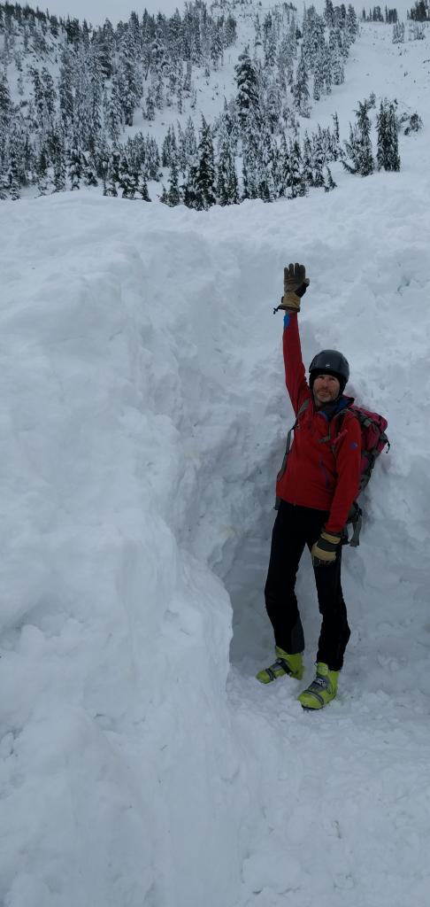 Standing in the hole where the skier was buried. He was buried prone in the area at my feet.