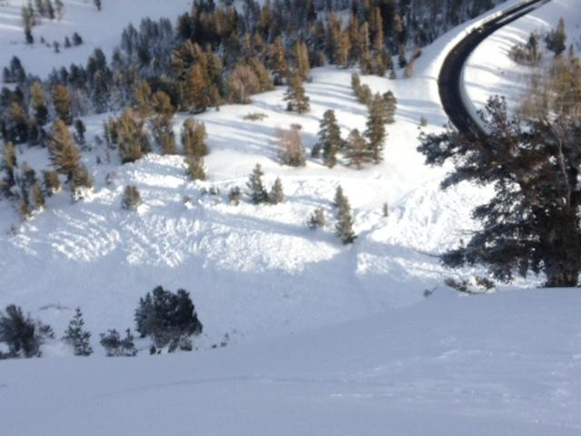 """Lookin down to debris from <a href=""""/avalanche-terms/crown-face"""" title=""""The top fracture surface of a slab avalanche. Usually smooth, clean cut, and angled 90 degrees to the bed surface."""" class=""""lexicon-term"""">crown</a> line in far lower left of overview photo."""