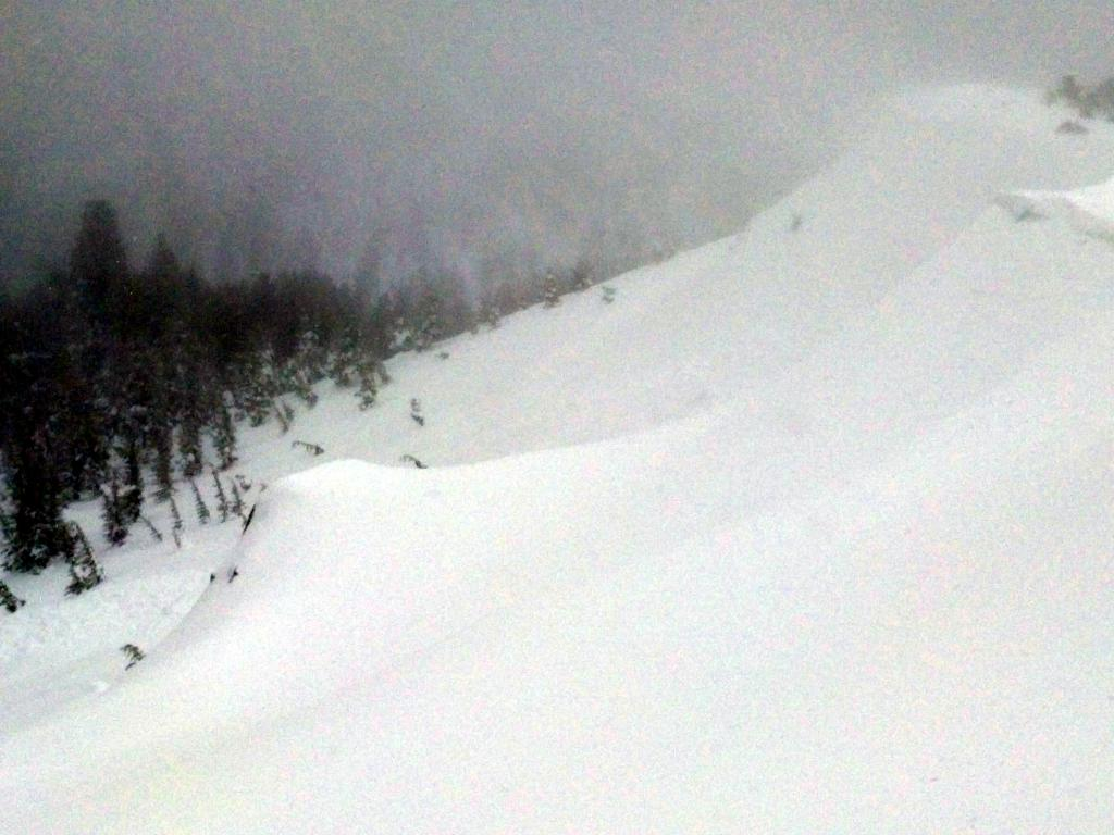 "Large cornices with a <a href=""http://www.sierraavalanchecenter.org/avalanche-terms/collapse"" title=""When the fracture of a lower snow layer causes an upper layer to fall. Also called a whumpf, this is an obvious sign of instability."" class=""lexicon-term"">collapsed</a> section and <a href=""http://www.sierraavalanchecenter.org/avalanche-terms/wind-slab"" title=""A cohesive layer of snow formed when wind deposits snow onto leeward terrain. Wind slabs are often smooth and rounded and sometimes sound hollow."" class=""lexicon-term"">wind slab</a> <a href=""http://www.sierraavalanchecenter.org/avalanche-terms/avalanche"" title=""A mass of snow sliding, tumbling, or flowing down an inclined surface."" class=""lexicon-term"">avalanche</a> below."