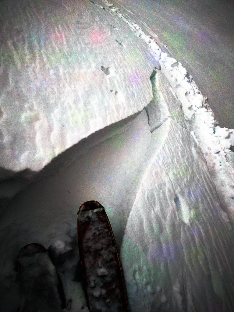 "<a href=""https://www.sierraavalanchecenter.org/avalanche-terms/wind-slab"" title=""A cohesive layer of snow formed when wind deposits snow onto leeward terrain. Wind slabs are often smooth and rounded and sometimes sound hollow."" class=""lexicon-term"">Wind slab</a> cracking in an undercut wind-<a href=""https://www.sierraavalanchecenter.org/avalanche-terms/loading"" title=""The addition of weight on top of a snowpack, usually from precipitation, wind drifting, or a person."" class=""lexicon-term"">loaded</a> slope"