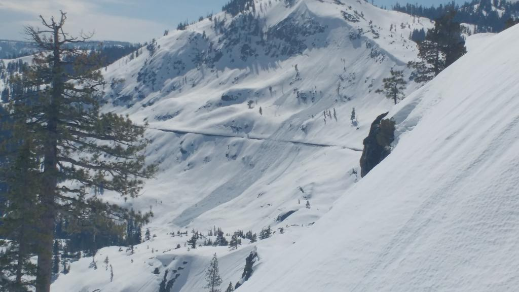 "Loose wet <a href=""https://www.sierraavalanchecenter.org/avalanche-terms/avalanche"" title=""A mass of snow sliding, tumbling, or flowing down an inclined surface."" class=""lexicon-term"">avalanche</a> size D2 <a href=""https://www.sierraavalanchecenter.org/avalanche-terms/trigger"" title=""A disturbance that initiates fracture within the weak layer causing an avalanche. In 90 percent of avalanche accidents, the victim or someone in the victims party triggers the avalanche."" class=""lexicon-term"">triggered</a> by natural <a href=""https://www.sierraavalanchecenter.org/avalanche-terms/cornice"" title=""A mass of snow deposited by the wind, often overhanging, and usually near a sharp terrain break such as a ridge. Cornices can break off unexpectedly and should be approached with caution."" class=""lexicon-term"">cornice</a> <a href=""https://www.sierraavalanchecenter.org/avalanche-terms/collapse"" title=""When the fracture of a lower snow layer causes an upper layer to fall. Also called a whumpf, this is an obvious sign of instability."" class=""lexicon-term"">collapse</a>."