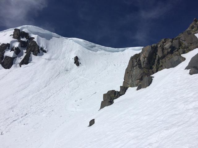 """Sagging cornices with debris from recent <a href=""""http://www.sierraavalanchecenter.org/avalanche-terms/cornice"""" title=""""A mass of snow deposited by the wind, often overhanging, and usually near a sharp terrain break such as a ridge. Cornices can break off unexpectedly and should be approached with caution."""" class=""""lexicon-term"""">cornice</a> failures widespread."""