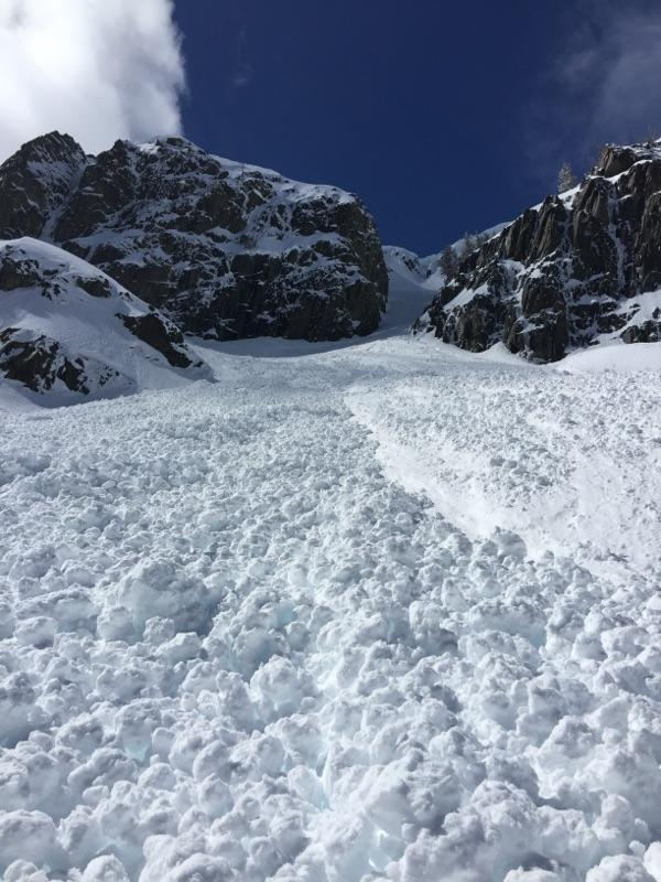 "Looking up <a href=""https://www.sierraavalanchecenter.org/avalanche-terms/avalanche"" title=""A mass of snow sliding, tumbling, or flowing down an inclined surface."" class=""lexicon-term"">avalanche</a> debris towards <a href=""https://www.sierraavalanchecenter.org/avalanche-terms/crown-face"" title=""The top fracture surface of a slab avalanche. Usually smooth, clean cut, and angled 90 degrees to the bed surface."" class=""lexicon-term"">crown</a>."