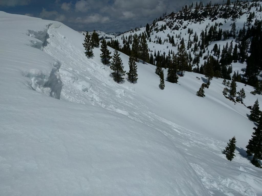 """Large <a href=""""http://www.sierraavalanchecenter.org/avalanche-terms/cornice"""" title=""""A mass of snow deposited by the wind, often overhanging, and usually near a sharp terrain break such as a ridge. Cornices can break off unexpectedly and should be approached with caution."""" class=""""lexicon-term"""">cornice</a> <a href=""""http://www.sierraavalanchecenter.org/avalanche-terms/collapse"""" title=""""When the fracture of a lower snow layer causes an upper layer to fall. Also called a whumpf, this is an obvious sign of instability."""" class=""""lexicon-term"""">collapse</a> likely from 4/18/2017"""