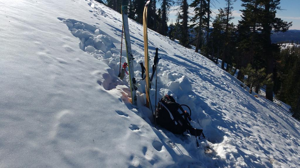 """<a href=""""https://www.sierraavalanchecenter.org/avalanche-terms/snowpit"""" title=""""A pit dug vertically into the snowpack where snow layering is observed and stability tests may be performed. Also called a snow profile."""" class=""""lexicon-term"""">Pit</a> location adjacent to and above <a href=""""https://www.sierraavalanchecenter.org/avalanche-terms/snowpit"""" title=""""A pit dug vertically into the snowpack where snow layering is observed and stability tests may be performed. Also called a snow profile."""" class=""""lexicon-term"""">pit</a> from Dec 6. (Skis/pack in old <a href=""""https://www.sierraavalanchecenter.org/avalanche-terms/snowpit"""" title=""""A pit dug vertically into the snowpack where snow layering is observed and stability tests may be performed. Also called a snow profile."""" class=""""lexicon-term"""">pit</a>.)"""