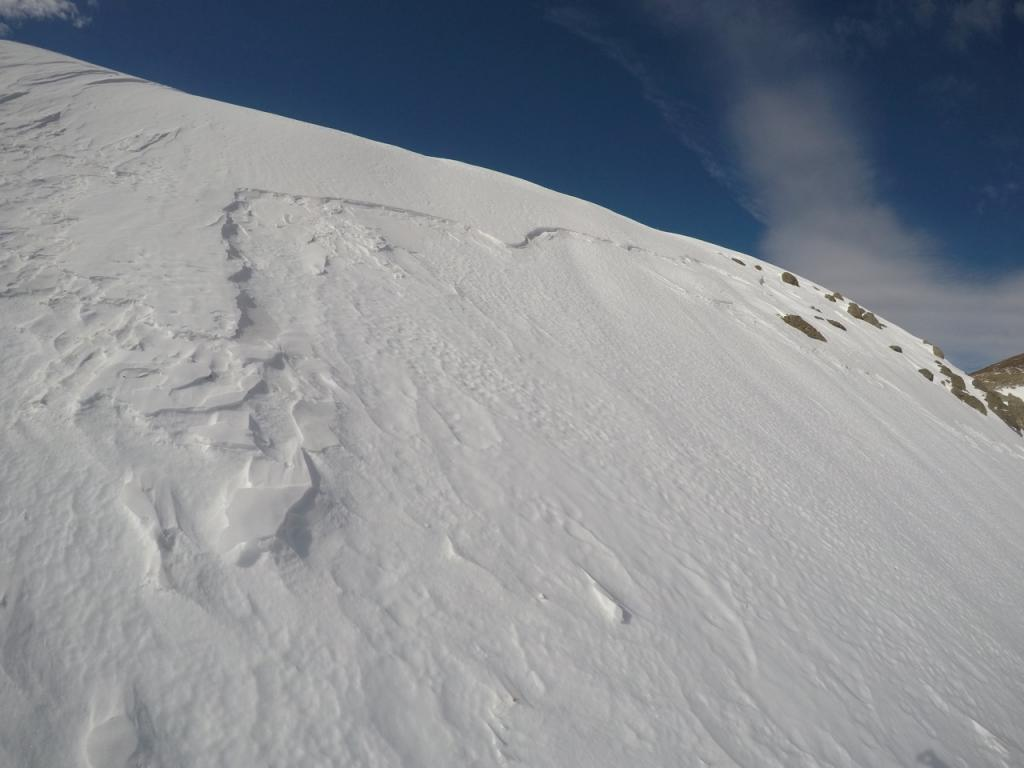 "Old <a href=""https://www.sierraavalanchecenter.org/avalanche-terms/crown-face"" title=""The top fracture surface of a slab avalanche. Usually smooth, clean cut, and angled 90 degrees to the bed surface."" class=""lexicon-term"">crown</a> below east facing ridge"