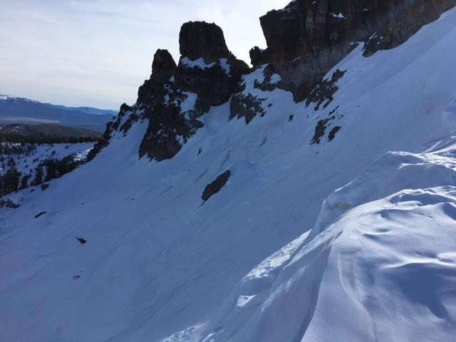 "Upper elevations on Castle Peak are firm, wind scoured surfaces on NW-N-NE <a href=""https://www.sierraavalanchecenter.org/avalanche-terms/aspect"" title=""The compass direction a slope faces (i.e. North, South, East, or West.)"" class=""lexicon-term"">aspects</a>."