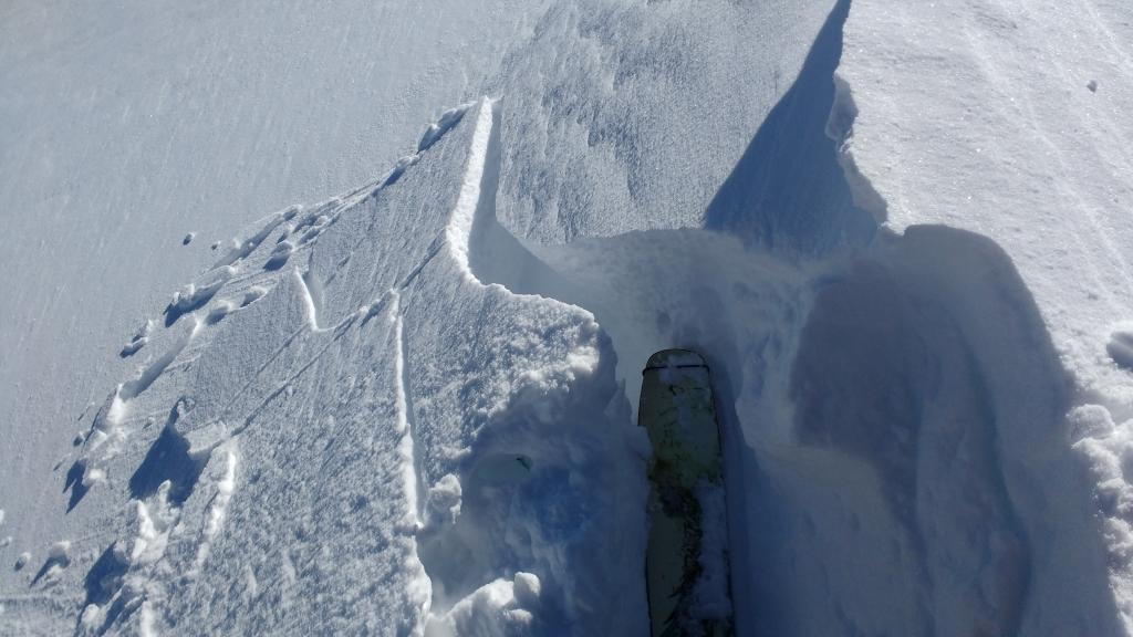 """Another intentionally cracked <a href=""""https://www.sierraavalanchecenter.org/avalanche-terms/wind-slab"""" title=""""A cohesive layer of snow formed when wind deposits snow onto leeward terrain. Wind slabs are often smooth and rounded and sometimes sound hollow."""" class=""""lexicon-term"""">wind slab</a> along summit ridge near noted lat/long."""
