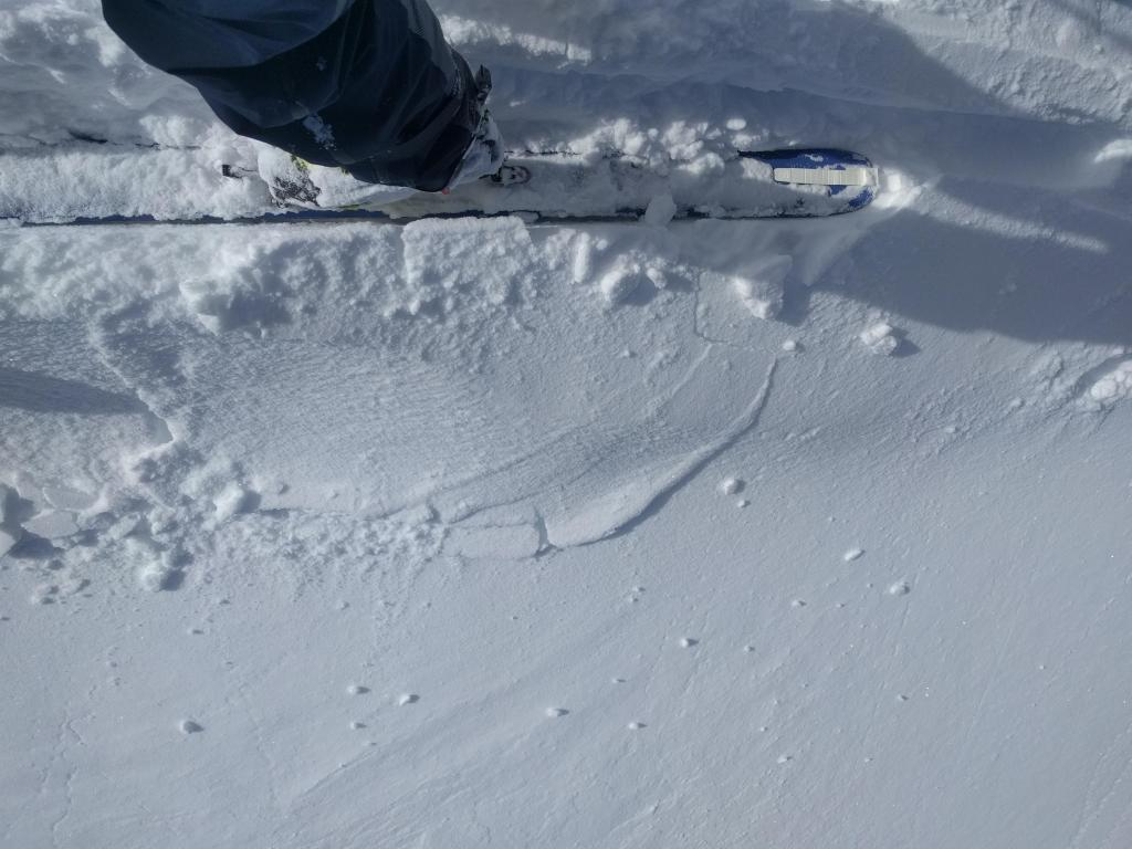 "Minor cracks that barely extend away from my skis on a traditionally wind-<a href=""https://www.sierraavalanchecenter.org/avalanche-terms/loading"" title=""The addition of weight on top of a snowpack, usually from precipitation, wind drifting, or a person."" class=""lexicon-term"">loaded</a> test slope on Andesite Peak."