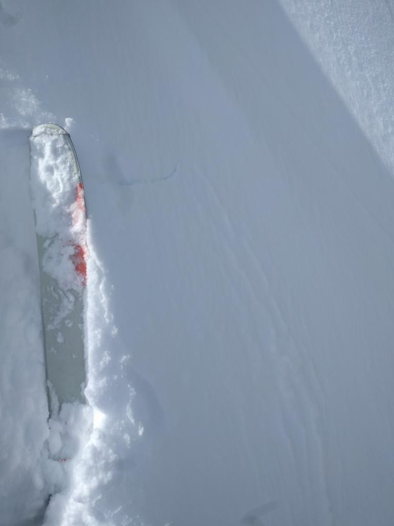 "Small cracking on a wind-<a href=""https://www.sierraavalanchecenter.org/avalanche-terms/loading"" title=""The addition of weight on top of a snowpack, usually from precipitation, wind drifting, or a person."" class=""lexicon-term"">loaded</a> test slope along the ridge. NE <a href=""https://www.sierraavalanchecenter.org/avalanche-terms/aspect"" title=""The compass direction a slope faces (i.e. North, South, East, or West.)"" class=""lexicon-term"">aspect</a> 8100 ft."