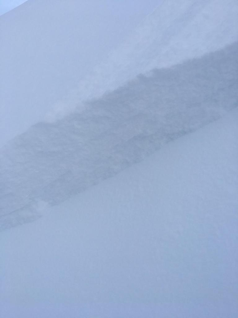 "<a href=""https://www.sierraavalanchecenter.org/avalanche-terms/wind-slab"" title=""A cohesive layer of snow formed when wind deposits snow onto leeward terrain. Wind slabs are often smooth and rounded and sometimes sound hollow."" class=""lexicon-term"">Wind Slab</a> <a href=""https://www.sierraavalanchecenter.org/avalanche-terms/crown-face"" title=""The top fracture surface of a slab avalanche. Usually smooth, clean cut, and angled 90 degrees to the bed surface."" class=""lexicon-term"">Crown</a> measuring 30-40cm"