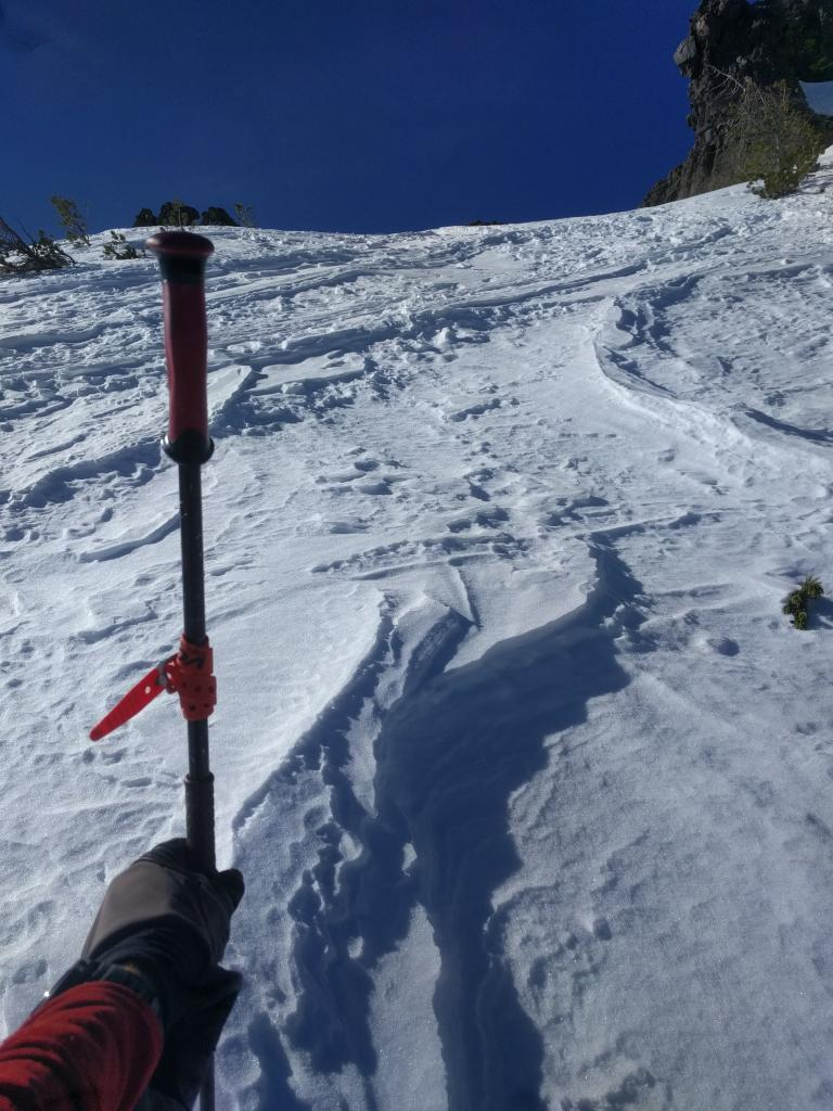 "Wind scoured exposed NE <a href=""https://www.sierraavalanchecenter.org/avalanche-terms/aspect"" title=""The compass direction a slope faces (i.e. North, South, East, or West.)"" class=""lexicon-term"">aspect</a> at 9600 ft."