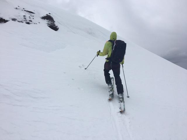 "Examining new <a href=""https://www.sierraavalanchecenter.org/avalanche-terms/wind-slab"" title=""A cohesive layer of snow formed when wind deposits snow onto leeward terrain. Wind slabs are often smooth and rounded and sometimes sound hollow."" class=""lexicon-term"">wind slab</a> of less than 2 inches deep and less than 6 foot downhill extent."