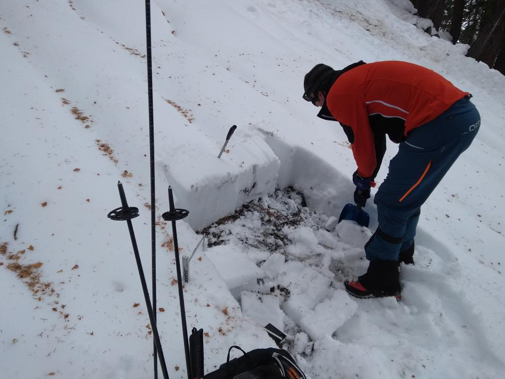 """<a href=""""/avalanche-terms/snowpit"""" title=""""A pit dug vertically into the snowpack where snow layering is observed and stability tests may be performed. Also called a snow profile."""" class=""""lexicon-term"""">Pit</a> location at 8,000&#039;, N <a href=""""/avalanche-terms/aspect"""" title=""""The compass direction a slope faces (i.e. North, South, East, or West.)"""" class=""""lexicon-term"""">aspect</a>."""