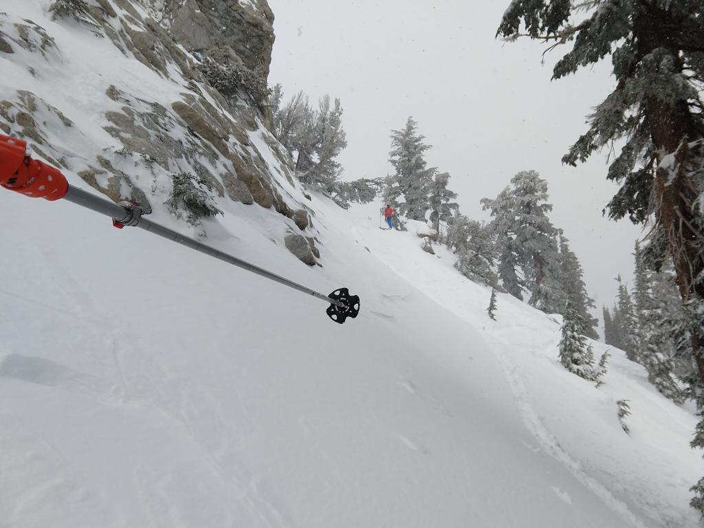 "Mostly filled in <a href=""https://www.sierraavalanchecenter.org/avalanche-terms/crown-face"" title=""The top fracture surface of a slab avalanche. Usually smooth, clean cut, and angled 90 degrees to the bed surface."" class=""lexicon-term"">crown</a> line from a small skier <a href=""https://www.sierraavalanchecenter.org/avalanche-terms/trigger"" title=""A disturbance that initiates fracture within the weak layer causing an avalanche. In 90 percent of avalanche accidents, the victim or someone in the victims party triggers the avalanche."" class=""lexicon-term"">triggered</a> <a href=""https://www.sierraavalanchecenter.org/avalanche-terms/wind-slab"" title=""A cohesive layer of snow formed when wind deposits snow onto leeward terrain. Wind slabs are often smooth and rounded and sometimes sound hollow."" class=""lexicon-term"">wind slab</a> <a href=""https://www.sierraavalanchecenter.org/avalanche-terms/avalanche"" title=""A mass of snow sliding, tumbling, or flowing down an inclined surface."" class=""lexicon-term"">avalanche</a> about 2 hours before we got there. NE <a href=""https://www.sierraavalanchecenter.org/avalanche-terms/aspect"" title=""The compass direction a slope faces (i.e. North, South, East, or West.)"" class=""lexicon-term"">aspect</a>, 39 degree slope, 9100 ft. The <a href=""https://www.sierraavalanchecenter.org/avalanche-terms/crown-face"" title=""The top fracture surface of a slab avalanche. Usually smooth, clean cut, and angled 90 degrees to the bed surface."" class=""lexicon-term"">crown</a> goes from where I am taking the photo to where my partner is standing."