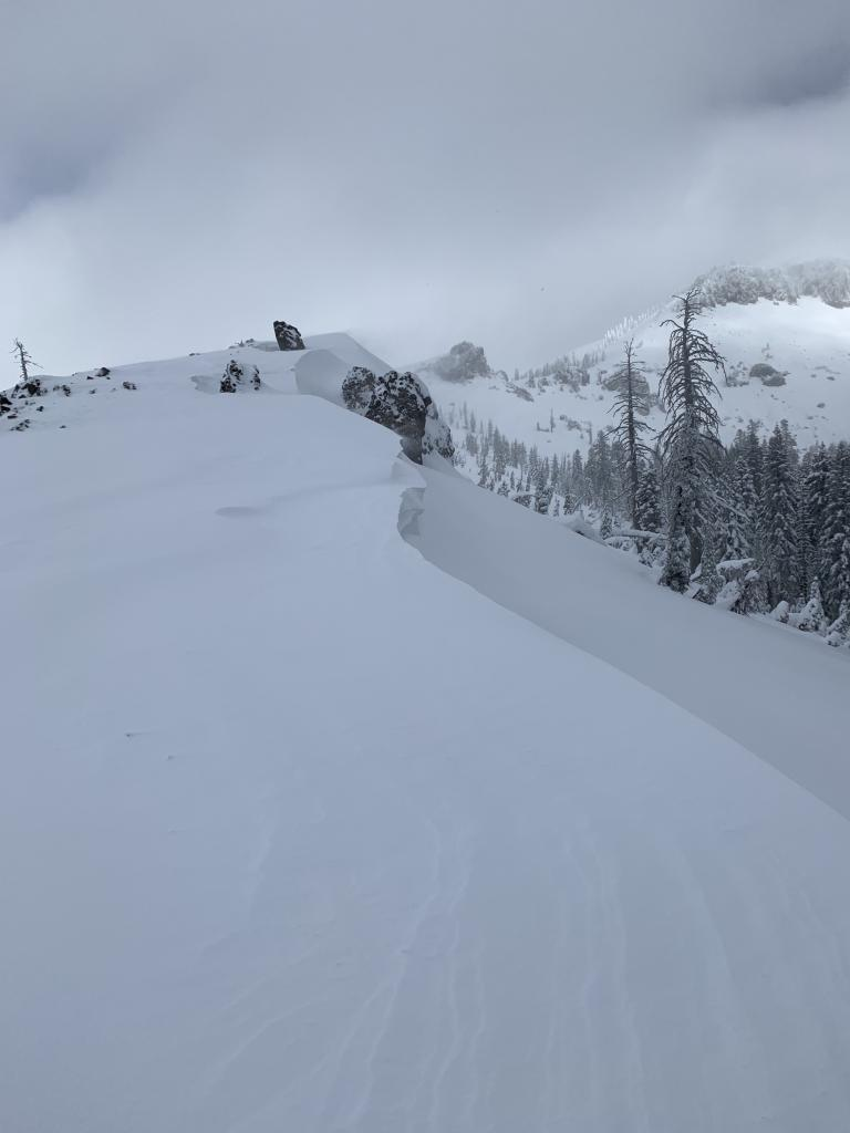 "<a href=""https://www.sierraavalanchecenter.org/avalanche-terms/wind-loading"" title=""The added weight of wind drifted snow."" class=""lexicon-term"">Wind loading</a> along the ridge-line"