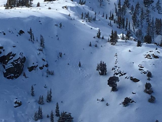 "<a href=""https://www.sierraavalanchecenter.org/avalanche-terms/wind-slab"" title=""A cohesive layer of snow formed when wind deposits snow onto leeward terrain. Wind slabs are often smooth and rounded and sometimes sound hollow."" class=""lexicon-term"">Wind slab</a> <a href=""https://www.sierraavalanchecenter.org/avalanche-terms/avalanche"" title=""A mass of snow sliding, tumbling, or flowing down an inclined surface."" class=""lexicon-term"">avalanche</a> with debris covered up by additional snow"