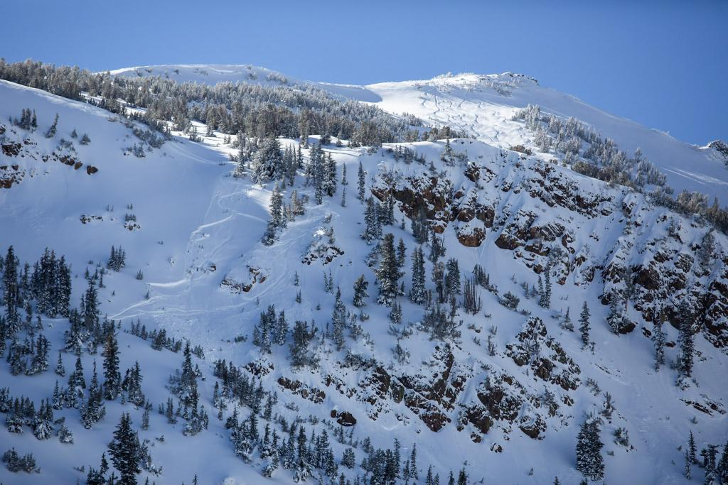 "Upper bowl of Red Lake peak is visible with previous ski tracks. The lower part of the <a href=""/avalanche-terms/avalanche-path"" title=""A terrain feature where an avalanche occurs. Composed of a Starting Zone, Track, and Runout Zone."" class=""lexicon-term"">avalanche path</a> is obscured by a small ridge line with trees."