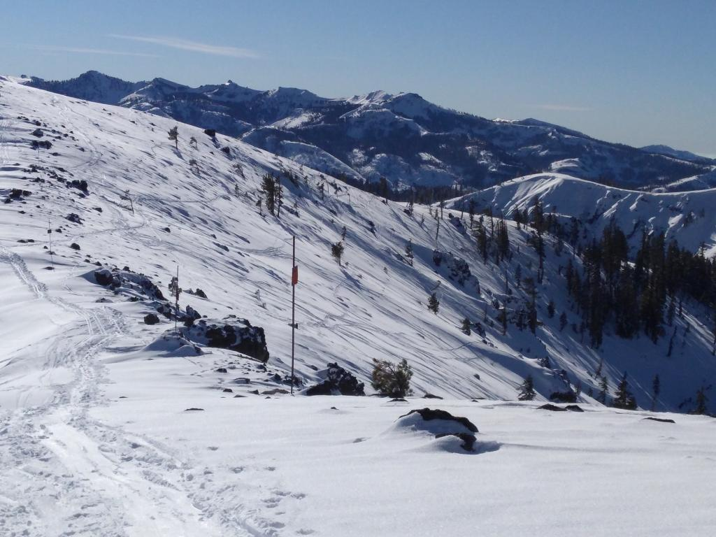 """Ski tracks on the <a href=""""https://www.sierraavalanchecenter.org/avalanche-terms/windward"""" title=""""The upwind side of an obstacle such as a ridge. Usually snow is eroded from windward slopes making them relatively safer."""" class=""""lexicon-term"""">windward</a> side of Judah indicating that soft snow is still available for transport if the winds increase."""