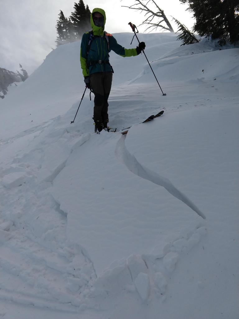 """Small wind pillow with some cracking. The <a href=""""/avalanche-terms/wind-slab"""" title=""""A cohesive layer of snow formed when wind deposits snow onto leeward terrain. Wind slabs are often smooth and rounded and sometimes sound hollow."""" class=""""lexicon-term"""">wind slab</a> only extended a few feet downslope."""