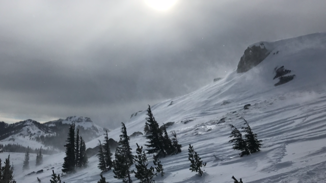 """wind scoured and side <a href=""""/avalanche-terms/loading"""" title=""""The addition of weight on top of a snowpack, usually from precipitation, wind drifting, or a person."""" class=""""lexicon-term"""">loading</a> below the ridge"""
