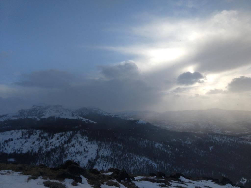 Increasing clouds and some light precipitation over the Sierra Crest in the late afternoon.