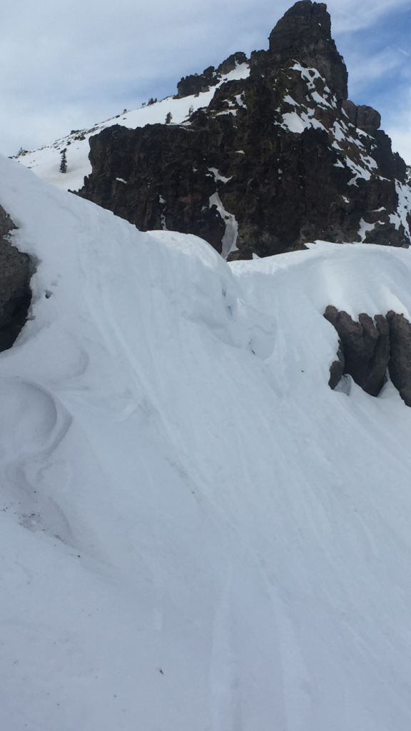 """Steep entrance with <a href=""""/avalanche-terms/cornice"""" title=""""A mass of snow deposited by the wind, often overhanging, and usually near a sharp terrain break such as a ridge. Cornices can break off unexpectedly and should be approached with caution."""" class=""""lexicon-term"""">cornice</a>"""