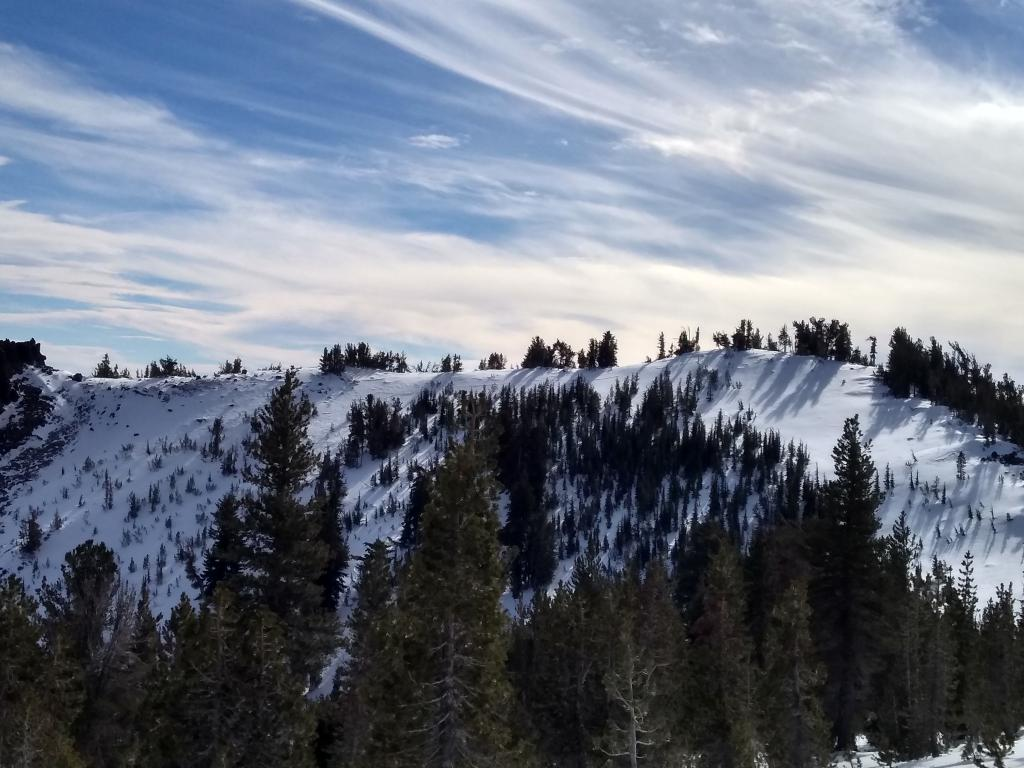 """No signs of blowing snow with ridge wind avg 40 mph, gusts to 60 mph on nearby <a href=""""https://www.sierraavalanchecenter.org/avalanche-terms/avalanche"""" title=""""A mass of snow sliding, tumbling, or flowing down an inclined surface."""" class=""""lexicon-term"""">Slide</a> sensor. Ridgeline to the NW of Incline Lake Peak."""