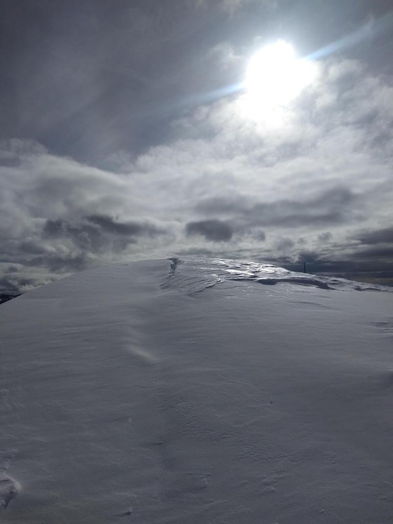 """Large cracks behind cornices from previous natural <a href=""""/avalanche-terms/cornice"""" title=""""A mass of snow deposited by the wind, often overhanging, and usually near a sharp terrain break such as a ridge. Cornices can break off unexpectedly and should be approached with caution."""" class=""""lexicon-term"""">cornice</a> failures."""