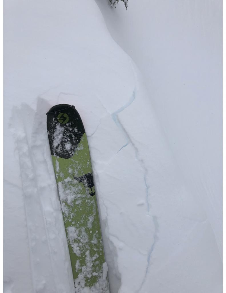 """Minor <a href=""""/avalanche-terms/cornice"""" title=""""A mass of snow deposited by the wind, often overhanging, and usually near a sharp terrain break such as a ridge. Cornices can break off unexpectedly and should be approached with caution."""" class=""""lexicon-term"""">cornice</a> cracking"""