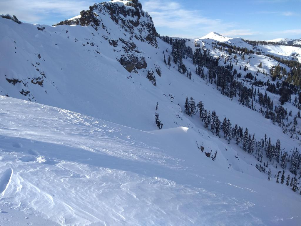 """<a href=""""https://www.sierraavalanchecenter.org/avalanche-terms/crown-face"""" title=""""The top fracture surface of a slab avalanche. Usually smooth, clean cut, and angled 90 degrees to the bed surface."""" class=""""lexicon-term"""">Crown</a> as see from the ridgetop to the east."""