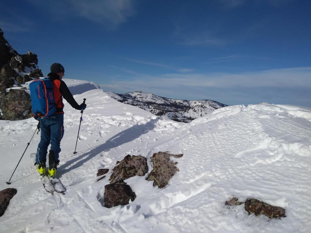 """Spot where footprints close to the edge <a href=""""https://www.sierraavalanchecenter.org/avalanche-terms/trigger"""" title=""""A disturbance that initiates fracture within the weak layer causing an avalanche. In 90 percent of avalanche accidents, the victim or someone in the victims party triggers the avalanche."""" class=""""lexicon-term"""">triggered</a> the <a href=""""https://www.sierraavalanchecenter.org/avalanche-terms/cornice"""" title=""""A mass of snow deposited by the wind, often overhanging, and usually near a sharp terrain break such as a ridge. Cornices can break off unexpectedly and should be approached with caution."""" class=""""lexicon-term"""">cornice</a> <a href=""""https://www.sierraavalanchecenter.org/avalanche-terms/collapse"""" title=""""When the fracture of a lower snow layer causes an upper layer to fall. Also called a whumpf, this is an obvious sign of instability."""" class=""""lexicon-term"""">collapse</a>."""