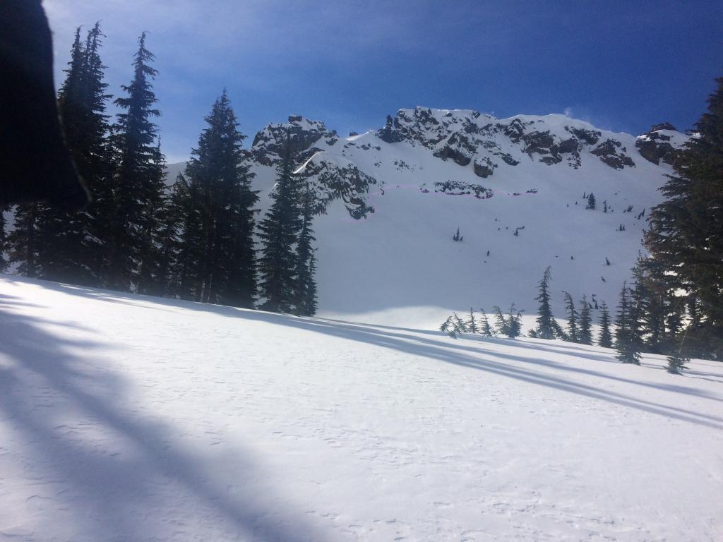 """A fairly large old <a href=""""/avalanche-terms/crown-face"""" title=""""The top fracture surface of a slab avalanche. Usually smooth, clean cut, and angled 90 degrees to the bed surface."""" class=""""lexicon-term"""">crown</a> at Needle Lake. Debris have since been buried under new/blowing snow"""