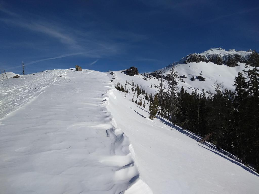 """Eroded cornices above SE <a href=""""https://www.sierraavalanchecenter.org/avalanche-terms/aspect"""" title=""""The compass direction a slope faces (i.e. North, South, East, or West.)"""" class=""""lexicon-term"""">aspect</a> terrain."""