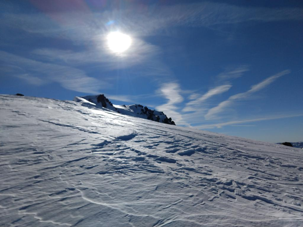 """Wind scoured N <a href=""""https://www.sierraavalanchecenter.org/avalanche-terms/aspect"""" title=""""The compass direction a slope faces (i.e. North, South, East, or West.)"""" class=""""lexicon-term"""">aspect</a> terrain."""