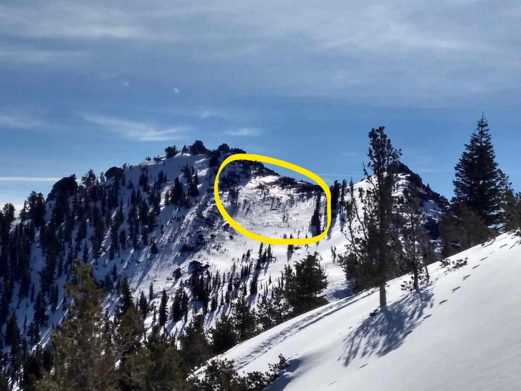 """Wind scouring down to exposed <a href=""""https://www.sierraavalanchecenter.org/avalanche-terms/rain-crust"""" title=""""A clear layer of ice formed when rain falls on the snow surface then freezes."""" class=""""lexicon-term"""">rain crust</a> on NE side of Peak 9,269'."""