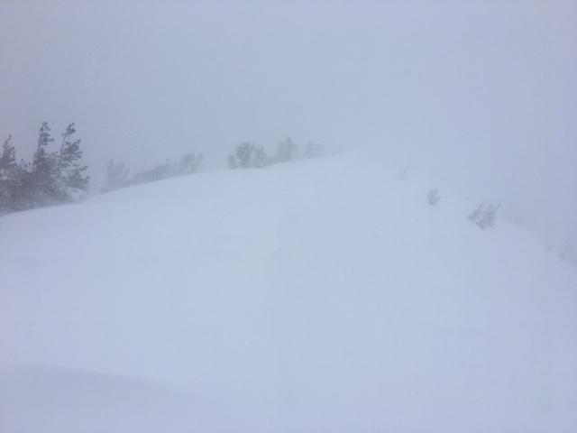 Blowing snow with limited visibility at 9200'.