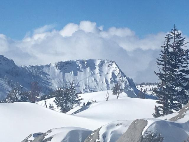 "<a href=""/avalanche-terms/crown-face"" title=""The top fracture surface of a slab avalanche. Usually smooth, clean cut, and angled 90 degrees to the bed surface."" class=""lexicon-term"">Crown</a> line visible mid slope on Crag Peak.  Seen from Jakes Peak"