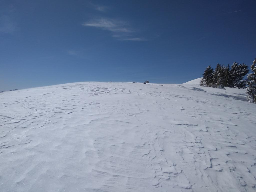 Minor wind scouring and blowing snow on the summit of Deep Creek Peak.
