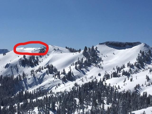 """Wind scouring down to exposed <a href=""""https://www.sierraavalanchecenter.org/avalanche-terms/rain-crust"""" title=""""A clear layer of ice formed when rain falls on the snow surface then freezes."""" class=""""lexicon-term"""">rain crust</a> near the ridgetop."""
