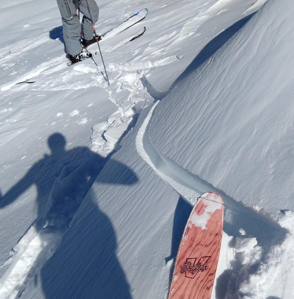 """Skier cracking on a low angle slope wind-<a href=""""https://www.sierraavalanchecenter.org/avalanche-terms/loading"""" title=""""The addition of weight on top of a snowpack, usually from precipitation, wind drifting, or a person."""" class=""""lexicon-term"""">loaded</a> by NE winds and previously undercut by the <a href=""""https://www.sierraavalanchecenter.org/avalanche-terms/skin-track"""" title=""""Backcountry skiers and some snowboarders ascend slopes using climbing skins attached to the bottom of their skis."""" class=""""lexicon-term"""">skin track</a>."""