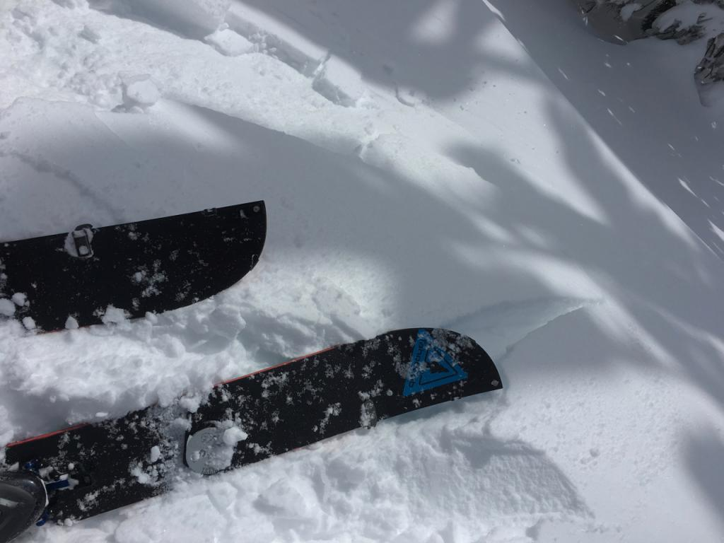 """Cracking and small <a href=""""https://www.sierraavalanchecenter.org/avalanche-terms/wind-slab"""" title=""""A cohesive layer of snow formed when wind deposits snow onto leeward terrain. Wind slabs are often smooth and rounded and sometimes sound hollow."""" class=""""lexicon-term"""">wind slab</a> <a href=""""https://www.sierraavalanchecenter.org/avalanche-terms/avalanche"""" title=""""A mass of snow sliding, tumbling, or flowing down an inclined surface."""" class=""""lexicon-term"""">slide</a> on test slope."""
