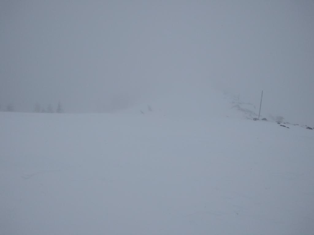 Looking along the Mt. Judah ridgeline with blowing snow and limited visibility.