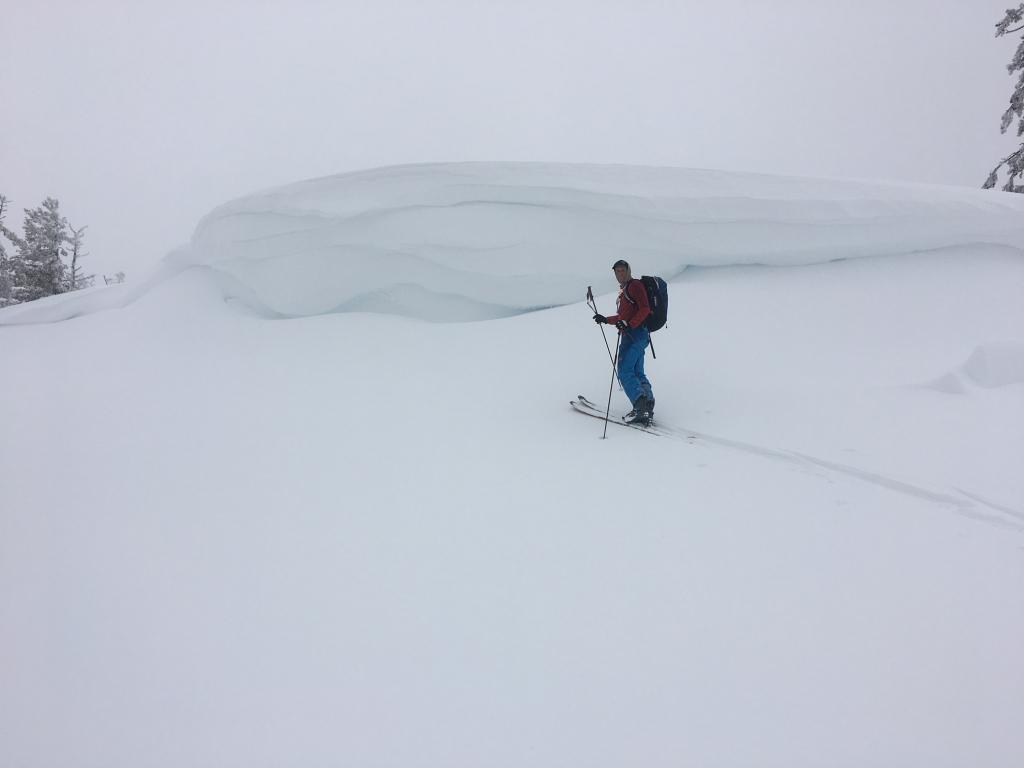 """Massive, layered <a href=""""https://www.sierraavalanchecenter.org/avalanche-terms/cornice"""" title=""""A mass of snow deposited by the wind, often overhanging, and usually near a sharp terrain break such as a ridge. Cornices can break off unexpectedly and should be approached with caution."""" class=""""lexicon-term"""">cornice</a>"""