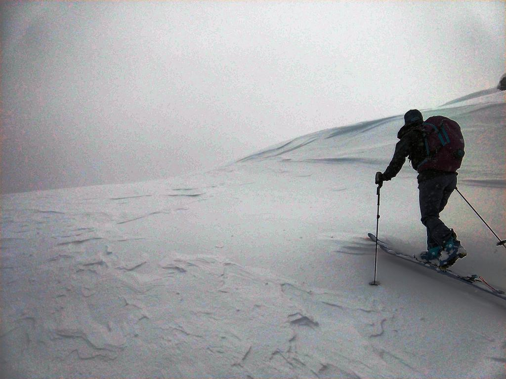 """Wind affected slope on the <a href=""""https://www.sierraavalanchecenter.org/avalanche-terms/windward"""" title=""""The upwind side of an obstacle such as a ridge. Usually snow is eroded from windward slopes making them relatively safer."""" class=""""lexicon-term"""">windward</a> side of a ridge."""