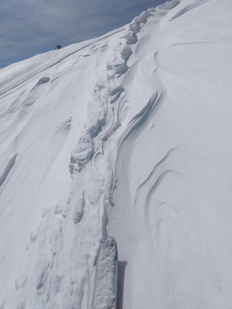 "Raised ski tracks on an E <a href=""https://www.sierraavalanchecenter.org/avalanche-terms/aspect"" title=""The compass direction a slope faces (i.e. North, South, East, or West.)"" class=""lexicon-term"">aspect</a> near the summit ridgeline"