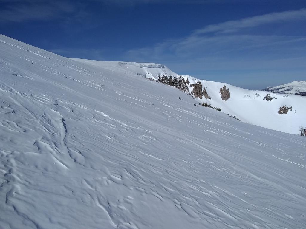 """Large <a href=""""https://www.sierraavalanchecenter.org/avalanche-terms/cornice"""" title=""""A mass of snow deposited by the wind, often overhanging, and usually near a sharp terrain break such as a ridge. Cornices can break off unexpectedly and should be approached with caution."""" class=""""lexicon-term"""">cornice</a> over Stevens north bowl"""