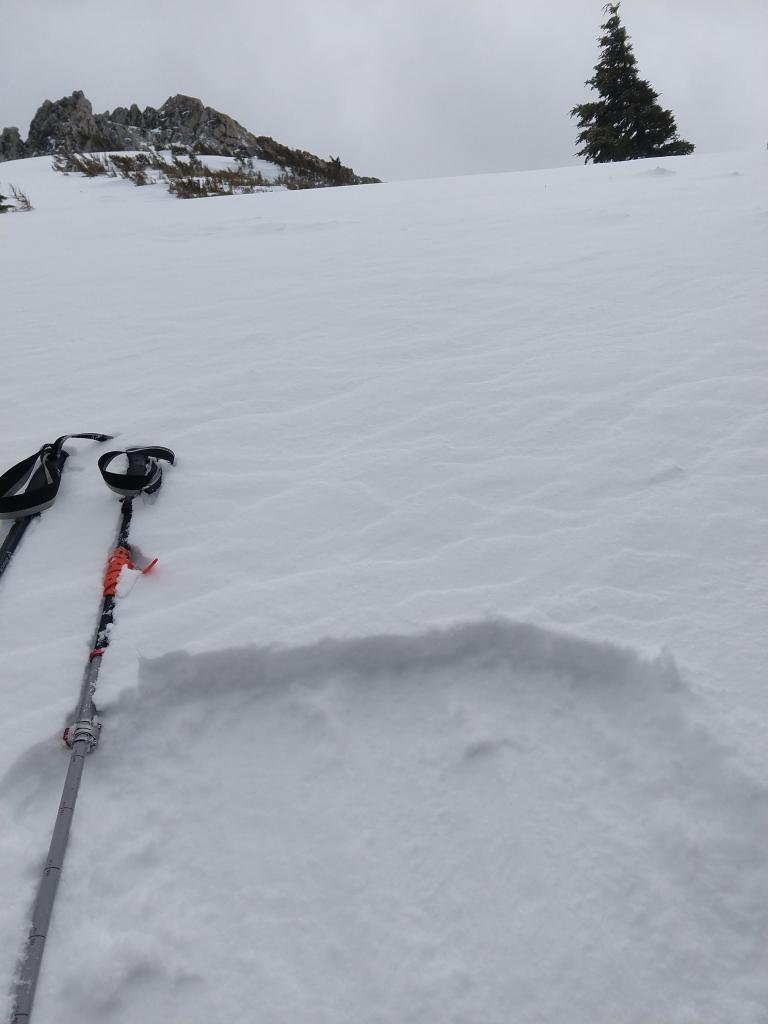 4 inches of wind affected snow near the summit of Rubicon