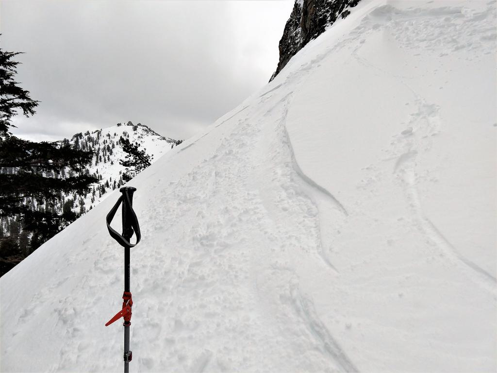 "Small inconsequential <a href=""/avalanche-terms/wind-slab"" title=""A cohesive layer of snow formed when wind deposits snow onto leeward terrain. Wind slabs are often smooth and rounded and sometimes sound hollow."" class=""lexicon-term"">wind slab</a> near the summit of Rubicon"